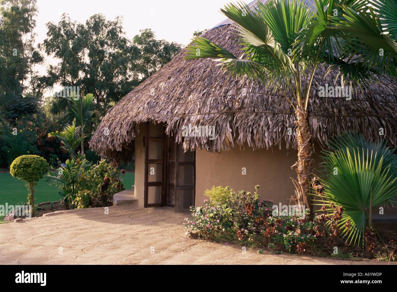Modern residential home in traditional tribal Rabari round mud hut Bunga style near Ahmedabad Gujarat state India - Stock Image