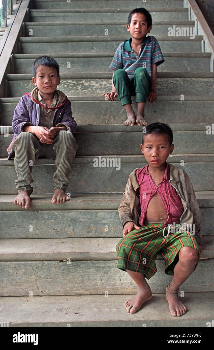 Kids on the monastery steps Shwe Min Bone village Shan State near Kalaw Burma - Stock Image