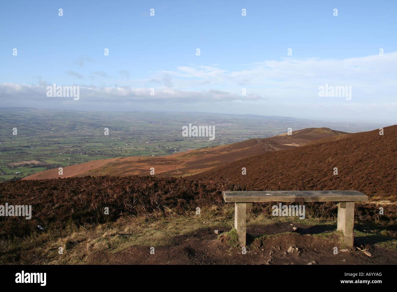 Seat on Moel Famau overlooking Clwyd Valley, towards North Wales coast - Stock Image