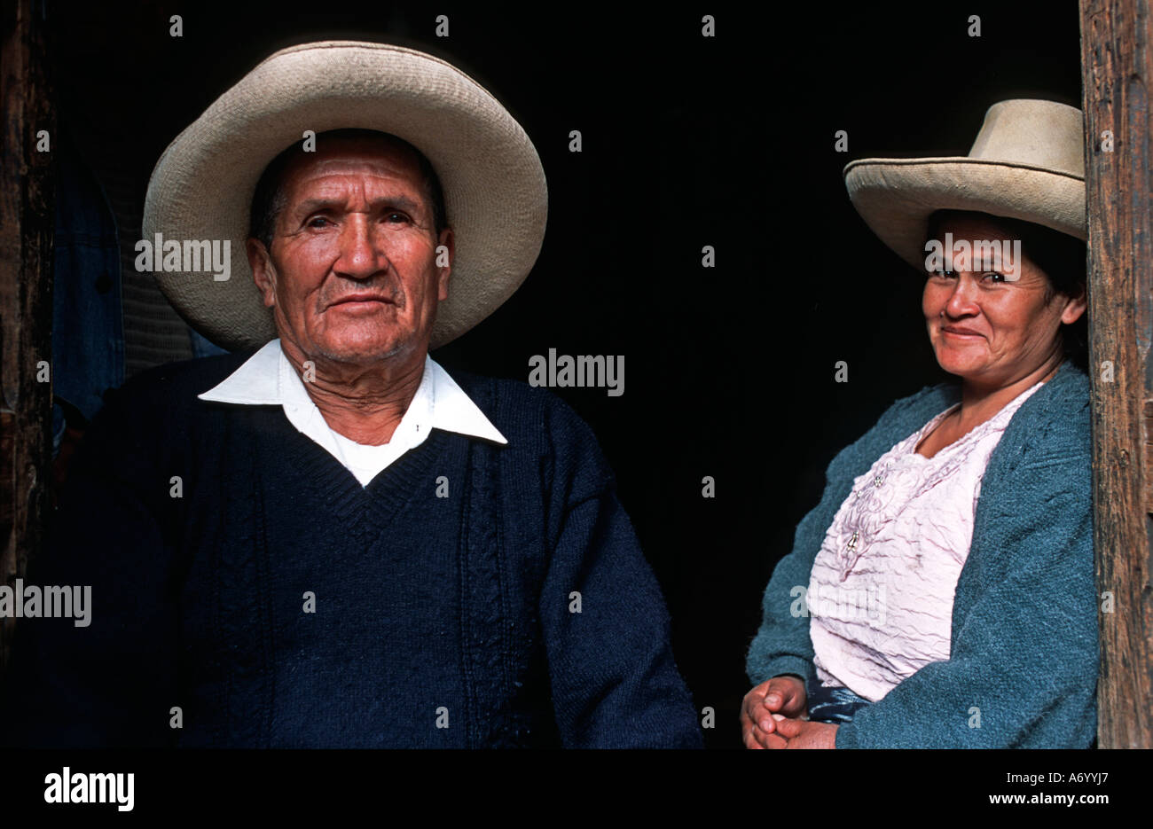 Peruvian couple at the dootway to their home Cajamarca Northern Peru - Stock Image