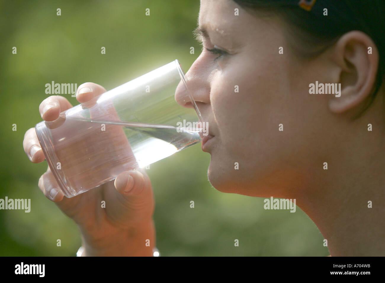 Heidelberg 28.06.2005, Vanessa drinks water - Stock Image
