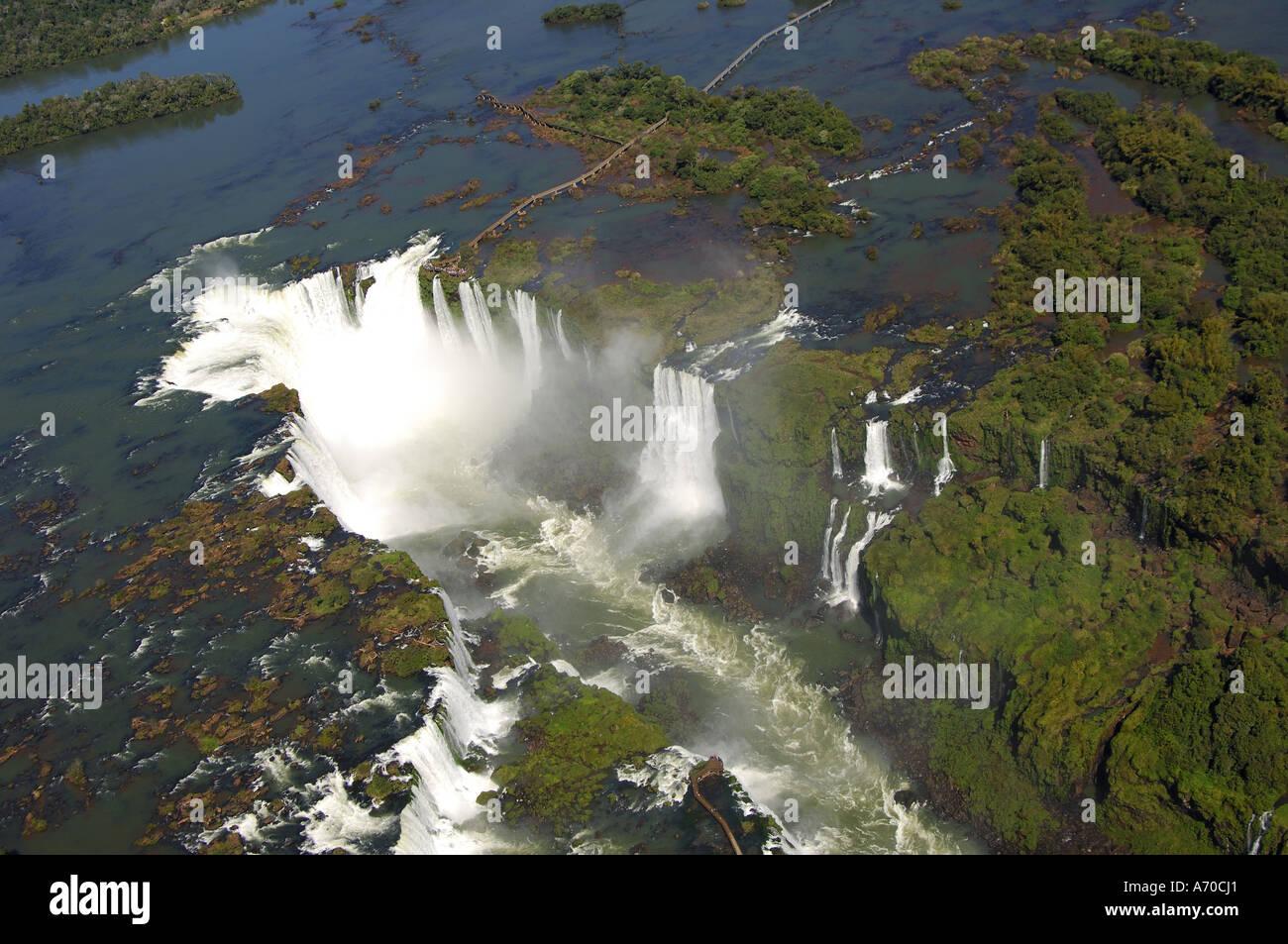 Devil's throat Iguazu Waterfalls aerial view observations platform Argentina centre above Brazil centre below Argentina Brazil - Stock Image