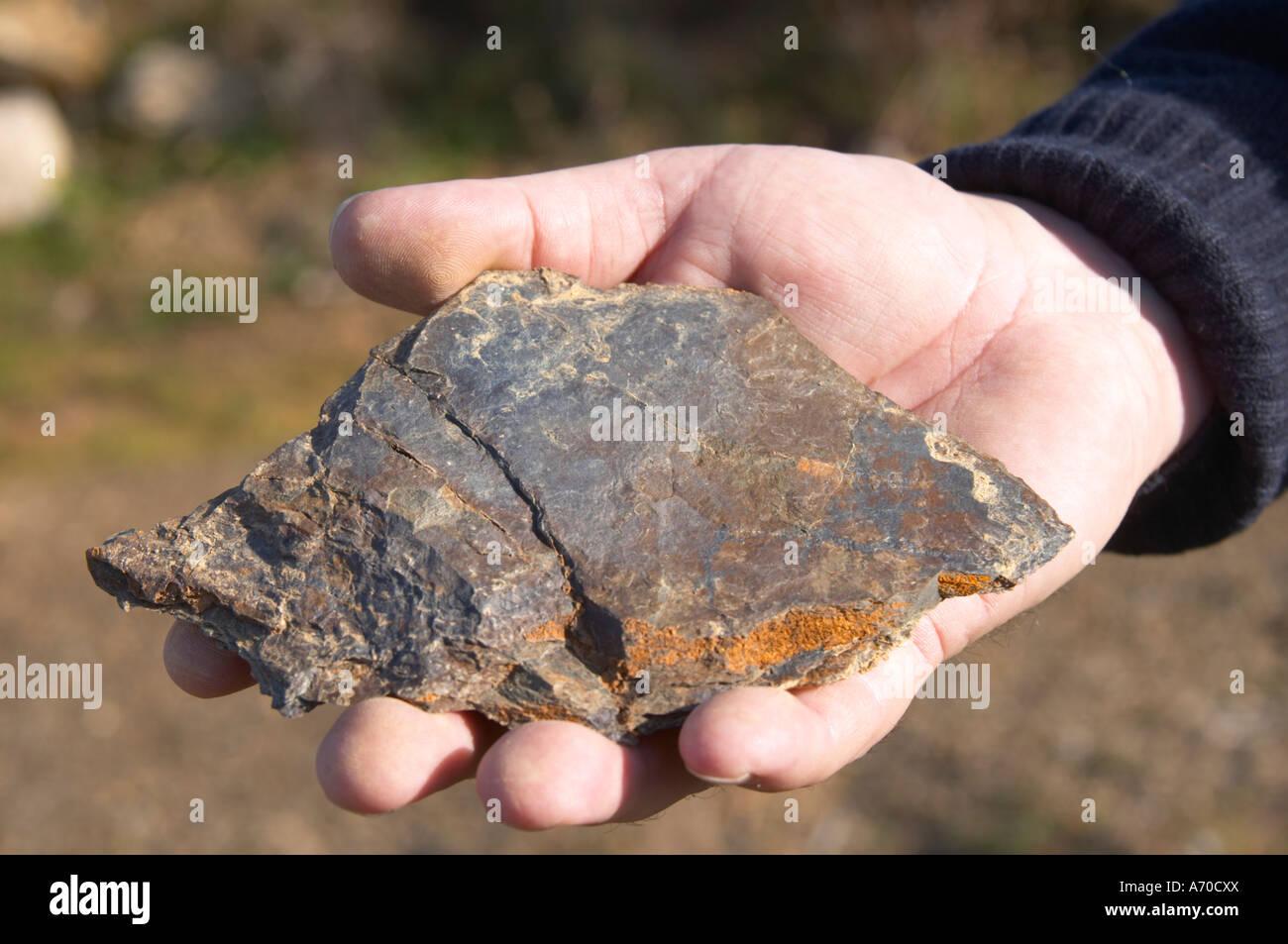 Domaine Mas Gabinele. Faugeres. Languedoc. Terroir soil. In the vineyard. Schist. France. Europe. Schist slate soil. - Stock Image