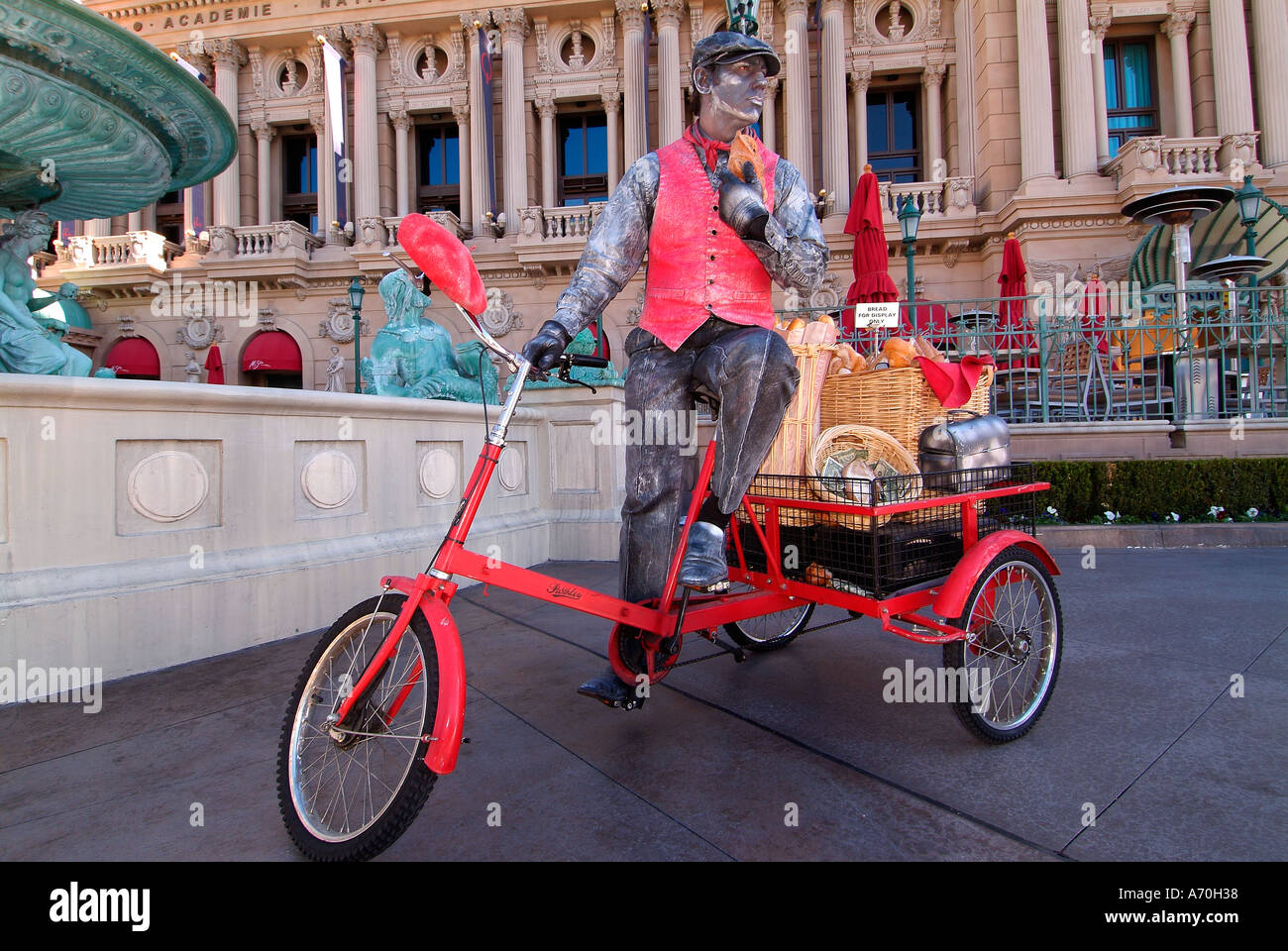 Mime with his bike in front of Paris casino in Las Vegas Nevada - Stock Image