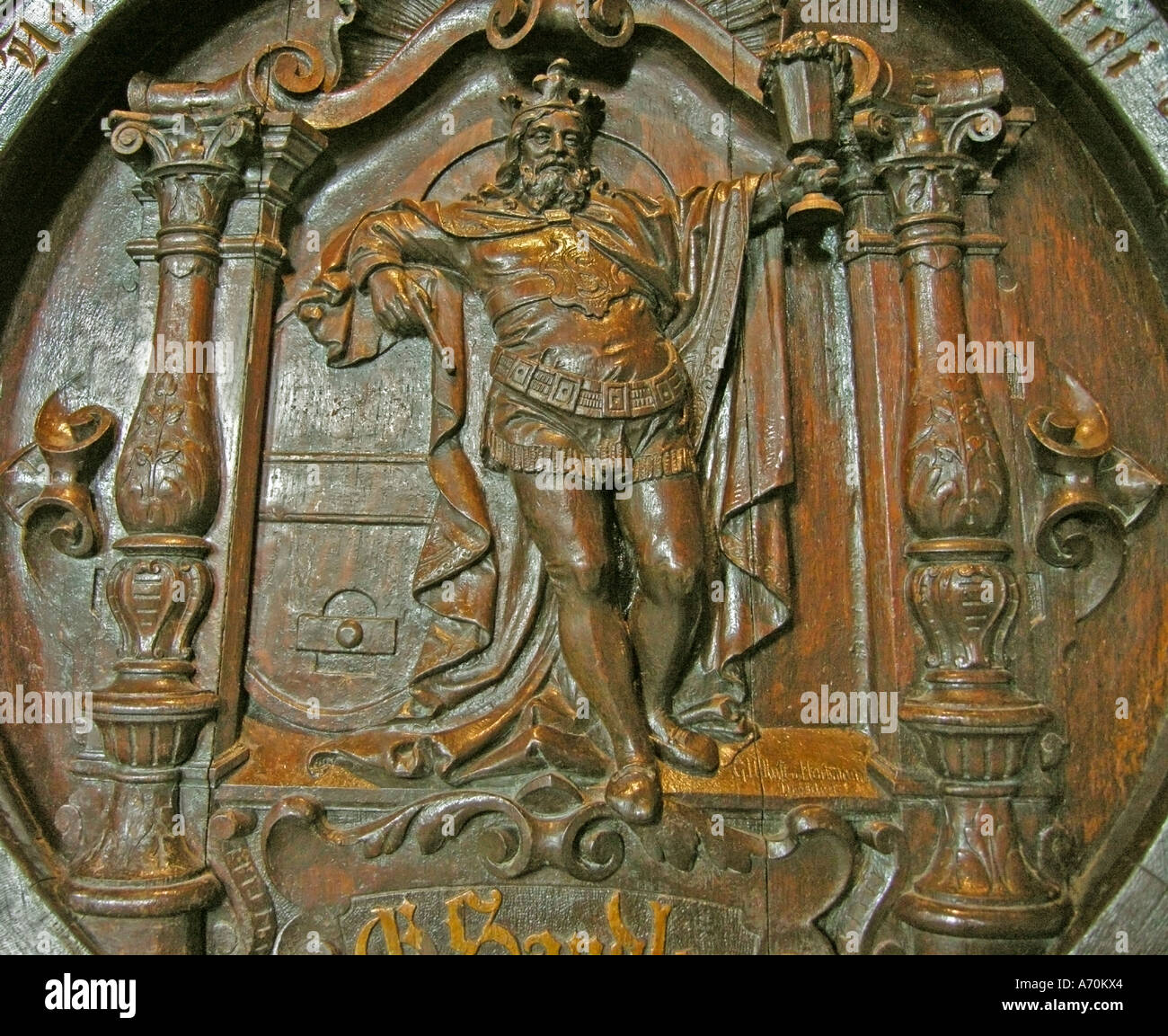 Artistic carvings on old wooden barrel in bavarian beer museum in