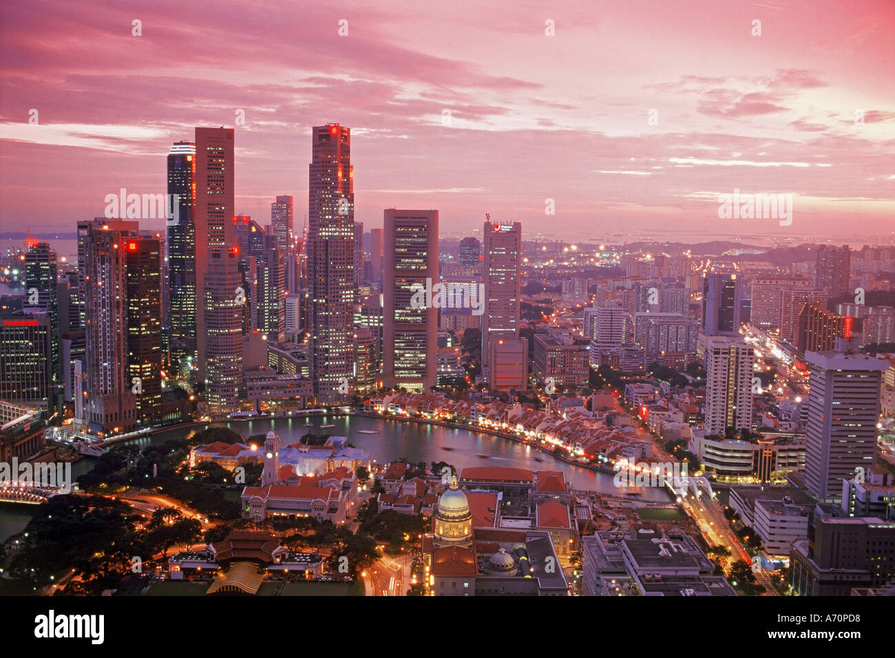 Central business district of Singapore at sunset - Stock Image