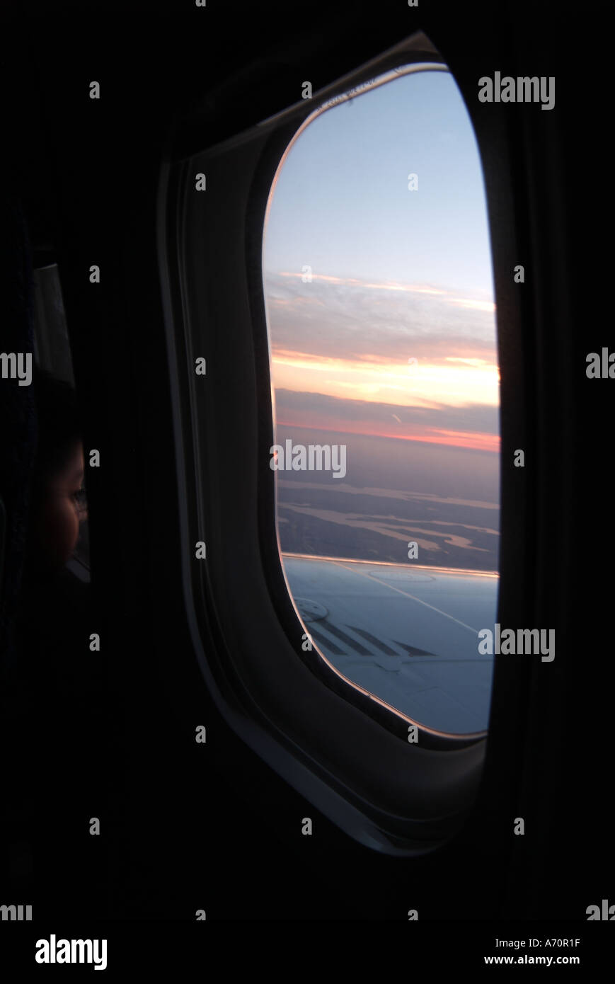 Sunset from a plane window - Stock Image
