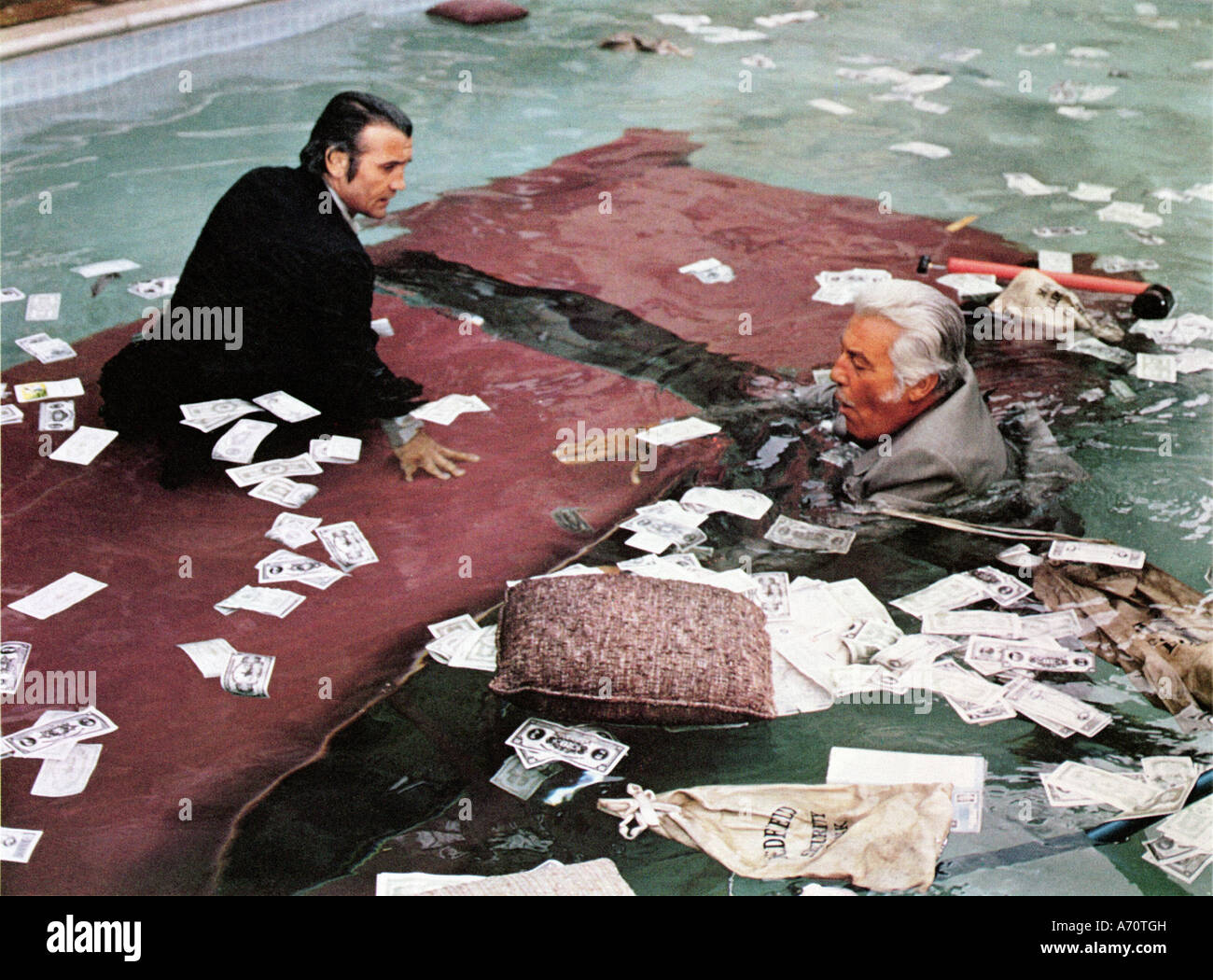 NOW YOU SEE HIM NOW YOU DON'T  1972 Disney film with Cesar Romero at right and Richard Bakalyan - Stock Image