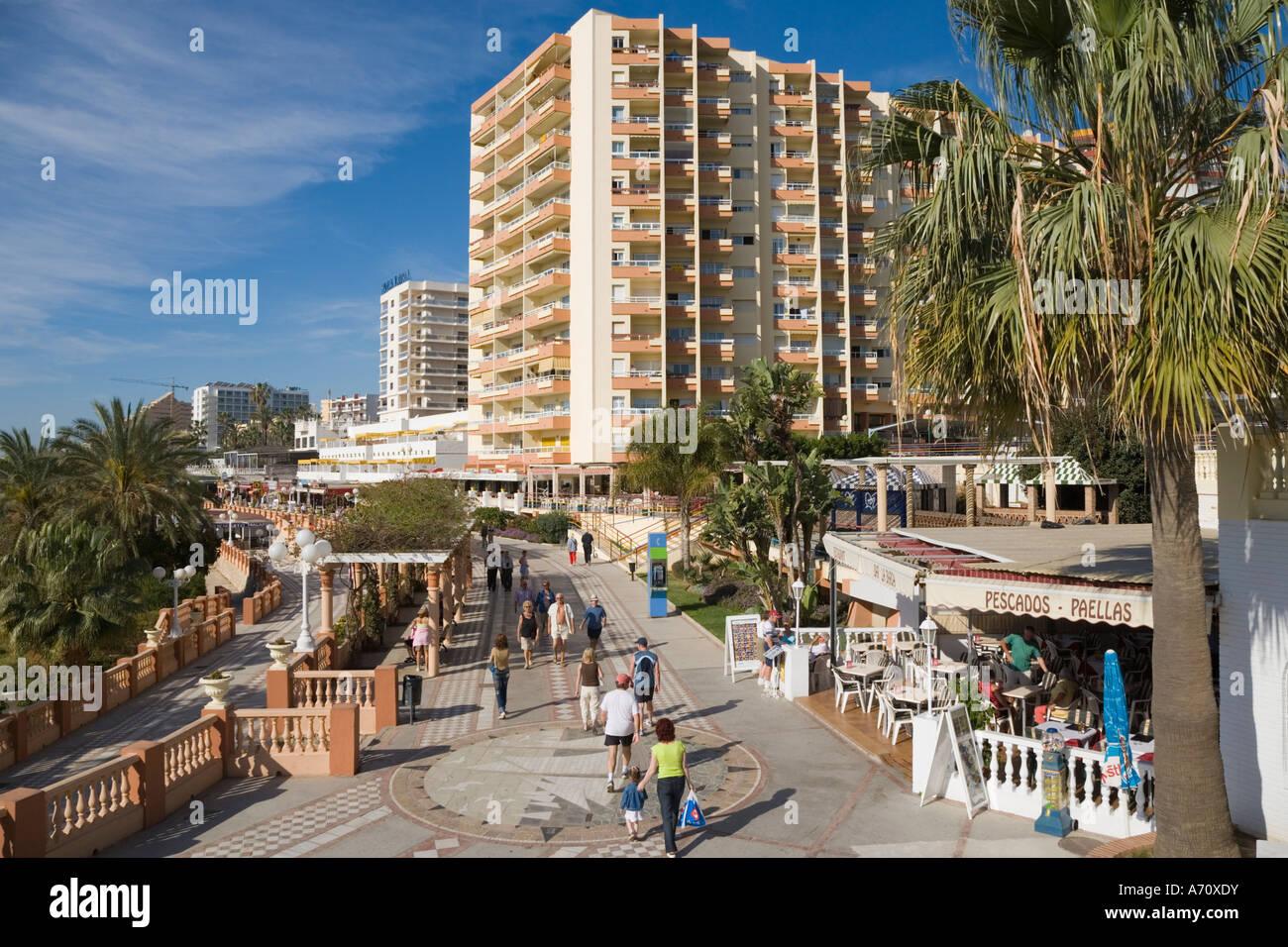 Benalmadena Costa Malaga Province Costa del Sol Spain People strolling on beach side promenade - Stock Image