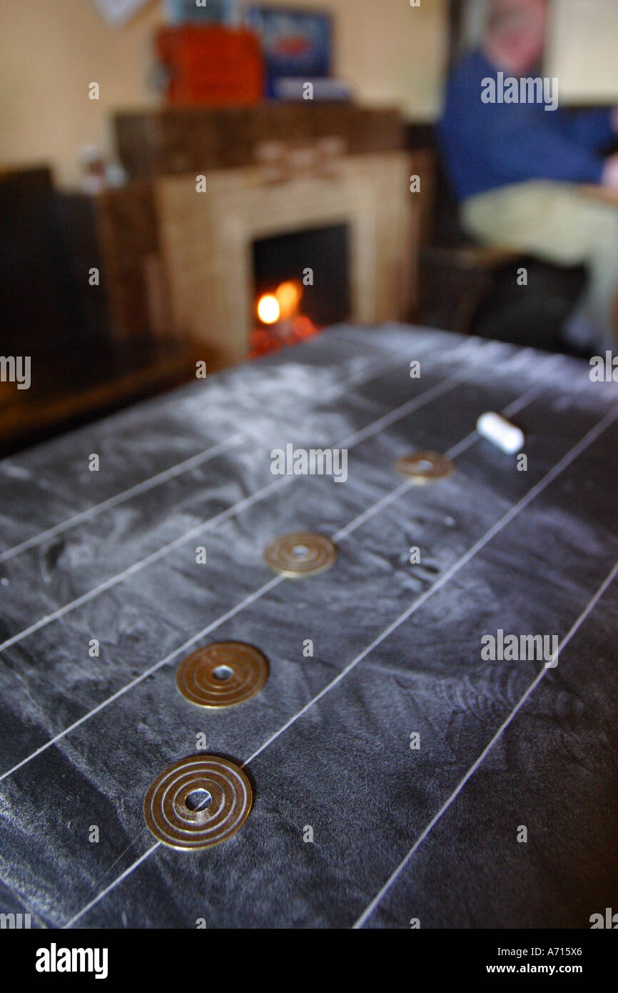 Traditional English pub game Shove Halfpenny in pub up on Mendip Hills in rural Somerset - Stock Image
