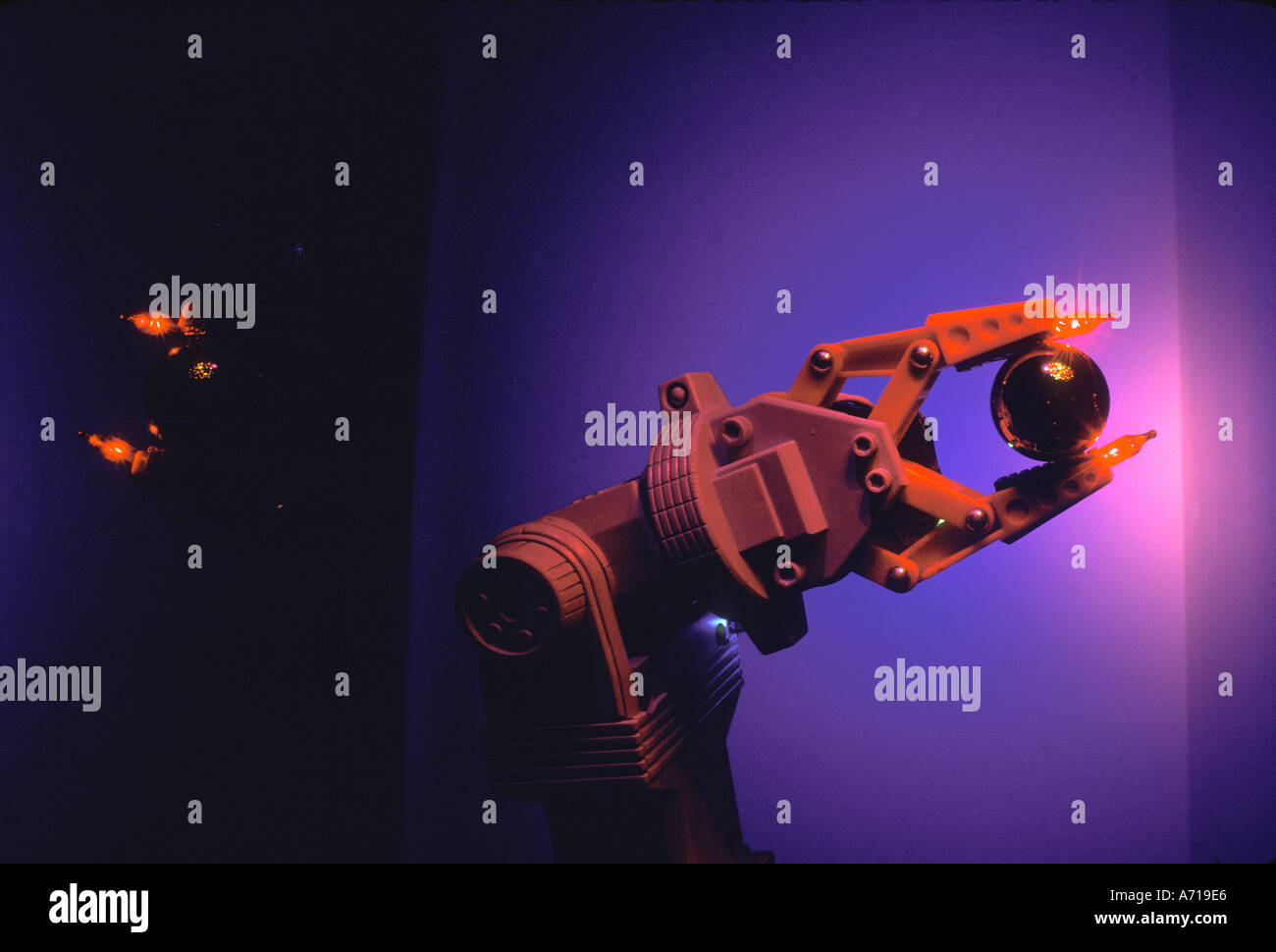 robotic arm holding black ball pink and blue lighting & robotic arm holding black ball pink and blue lighting Stock Photo ...