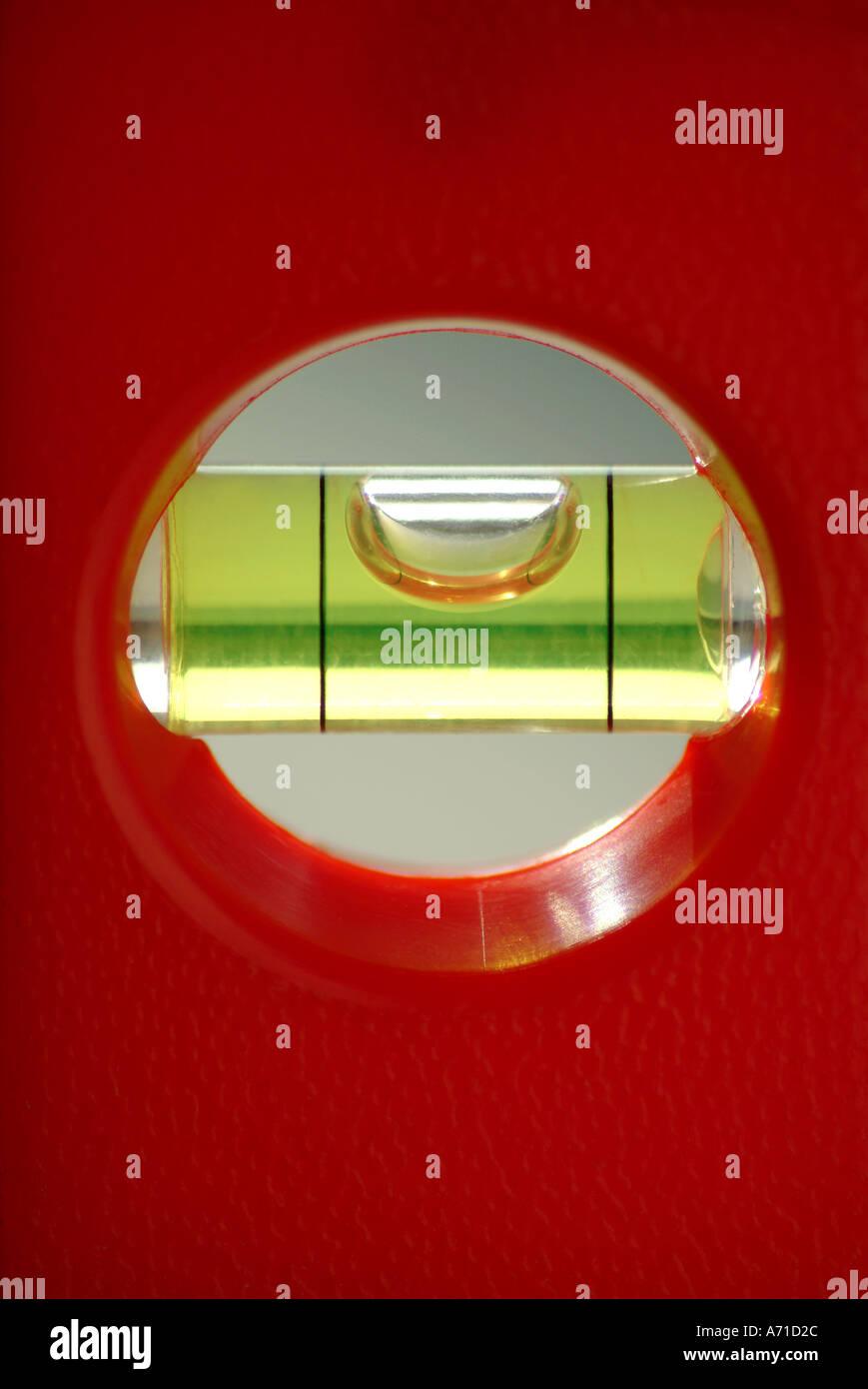 red spirit level bubble - Stock Image