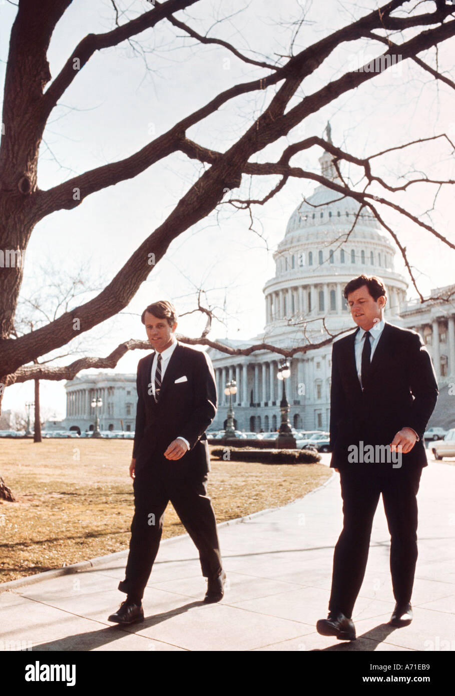 Senators Robert F Kennedy and brother Ted Kennedy walk from the Senate side of the U S Capitol to their senate offices nearby - Stock Image