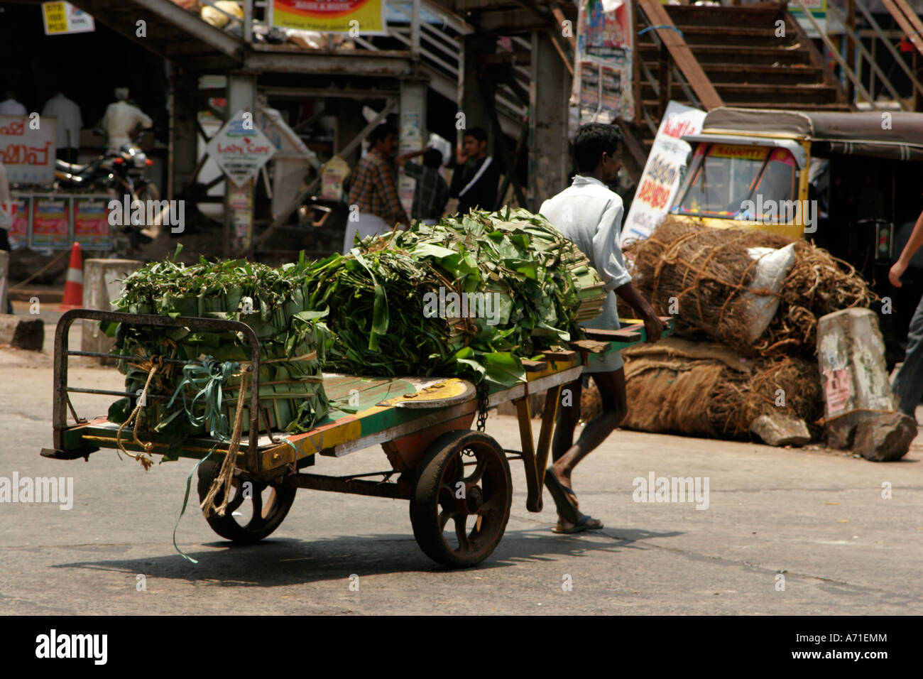Laborer pulling the cart in the village market used for transporting vegetables at Kurg, Kerela India - Stock Image