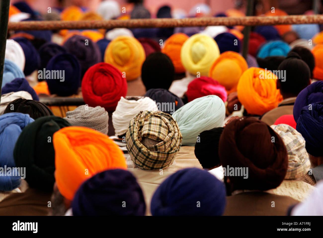 Group of Sikhs joined at Anand Pur Sahib guruwara on the occasion of Baisakhi, Punjab India Stock Photo