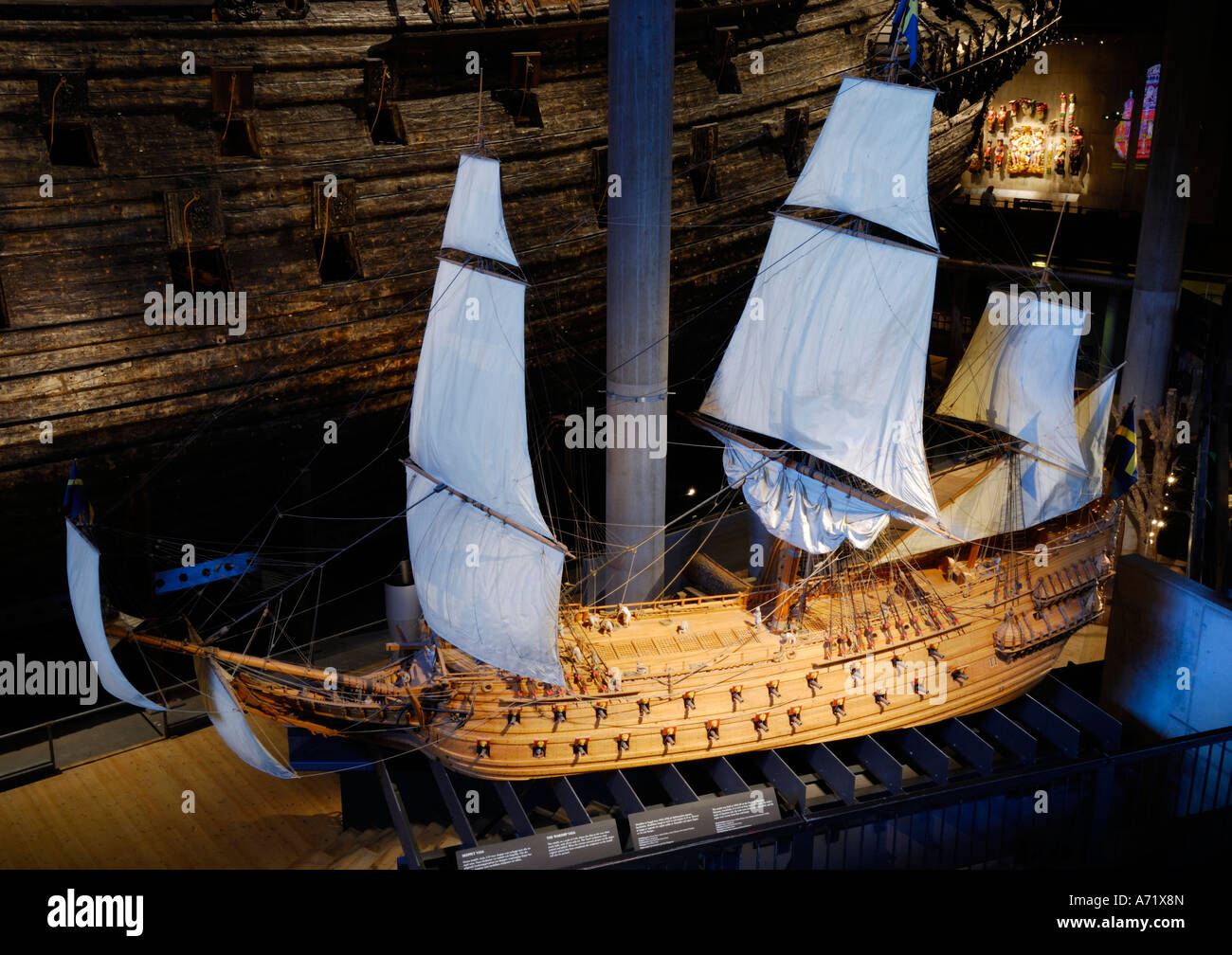A 3 to 4 meters long model of the 17th century battleship Vasa real ship in the background at the Vasa museum in Stockholm Stock Photo