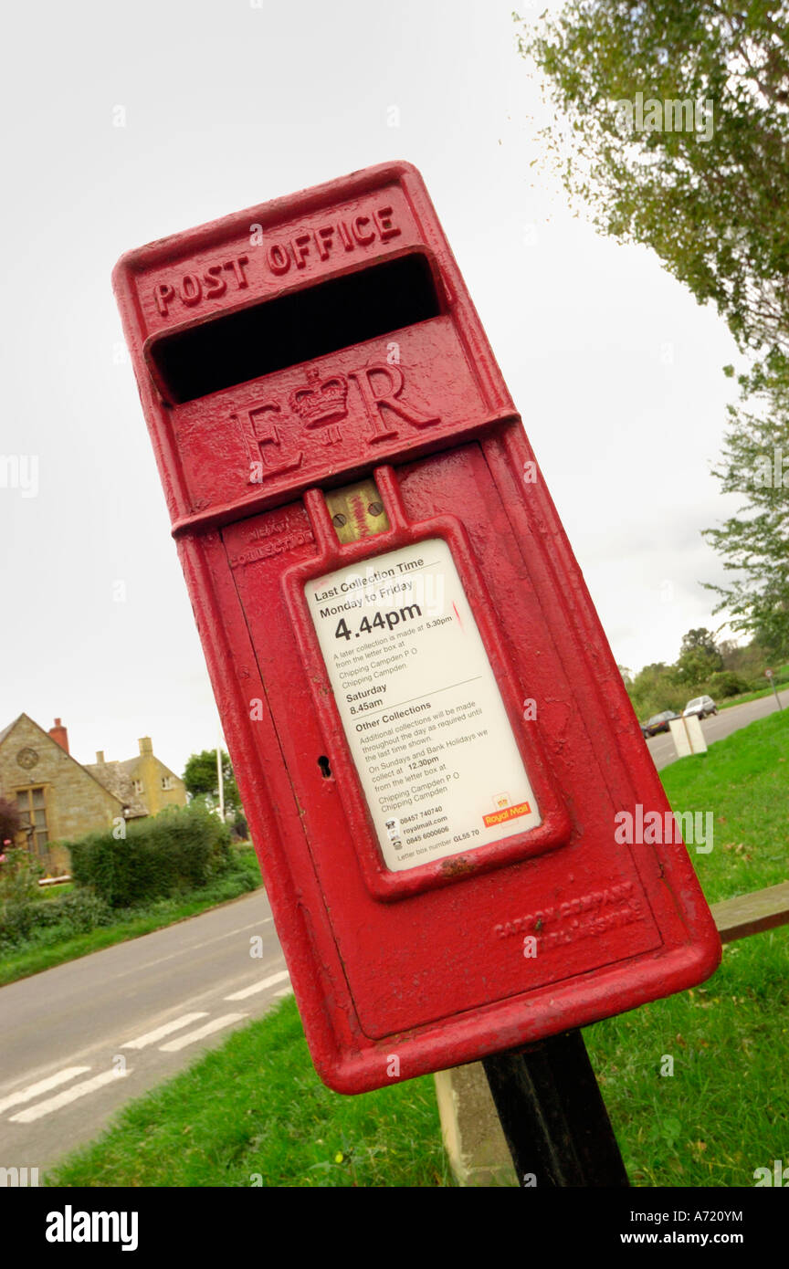 British red postbox for sending mail and postcards - Stock Image