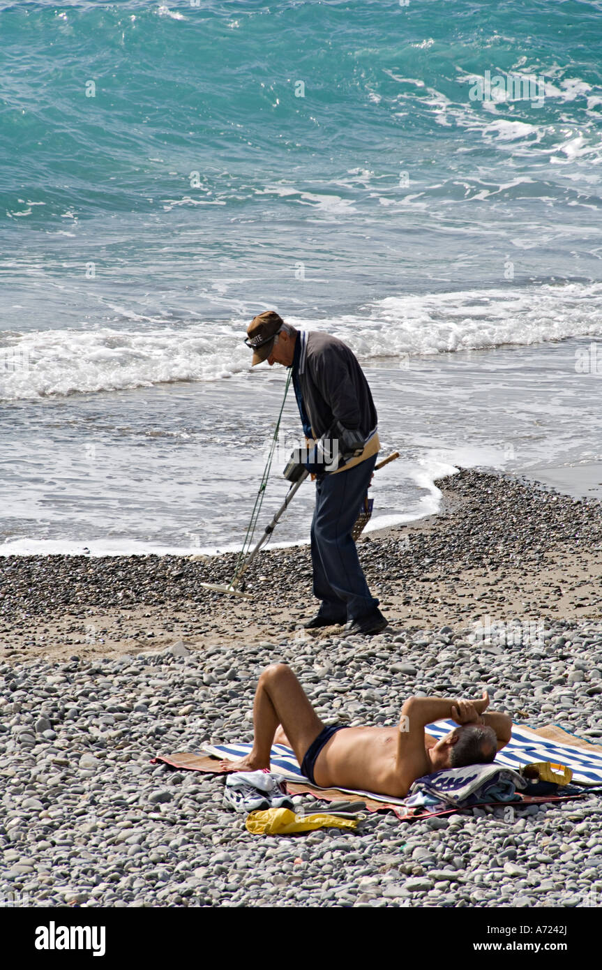 Beach metal detecting - Promenade des Anglais, Nice Cote d'Azur France -  French Riviera - Stock Image
