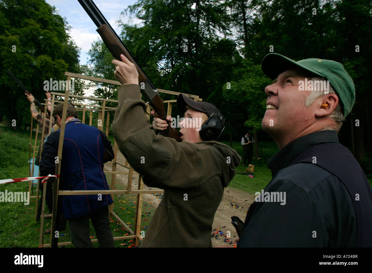 A beater encourages his son during a clay pigeon shoot organised by the Hambleden Estate - Stock Image