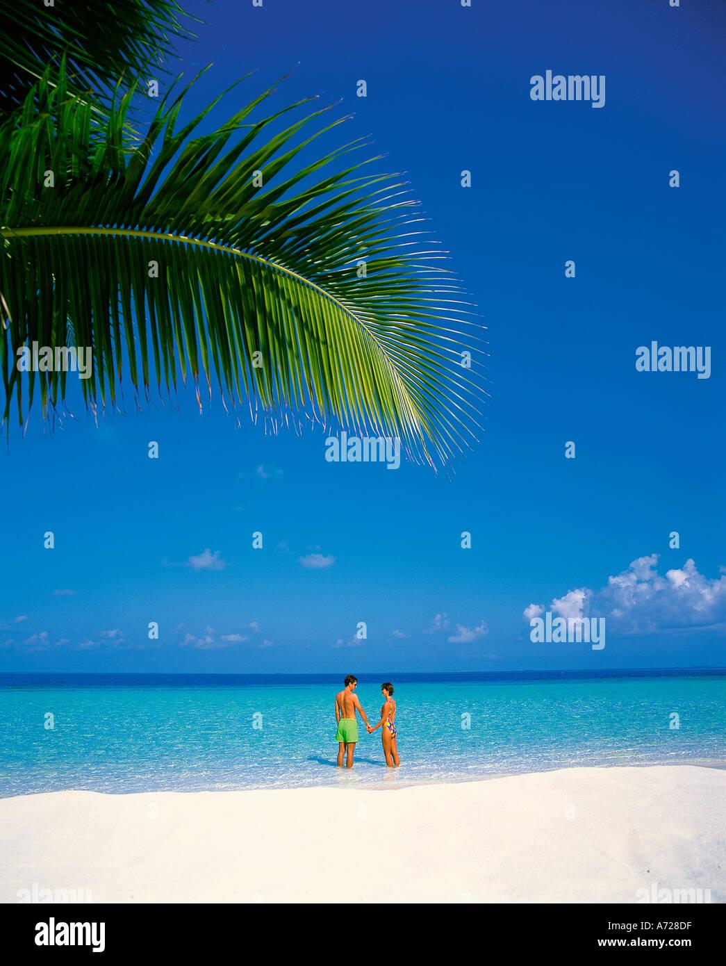 Couple On Tropical Island Beach At Ari Atoll Maldive Islands Indian