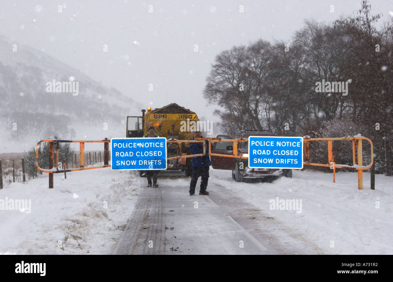 Chained Snow gates & access road closed sign; A93 Braemar, Glenshee, Blairgowrie road after winter blizzard, Cairngorms National Park, Scotland uk - Stock Image