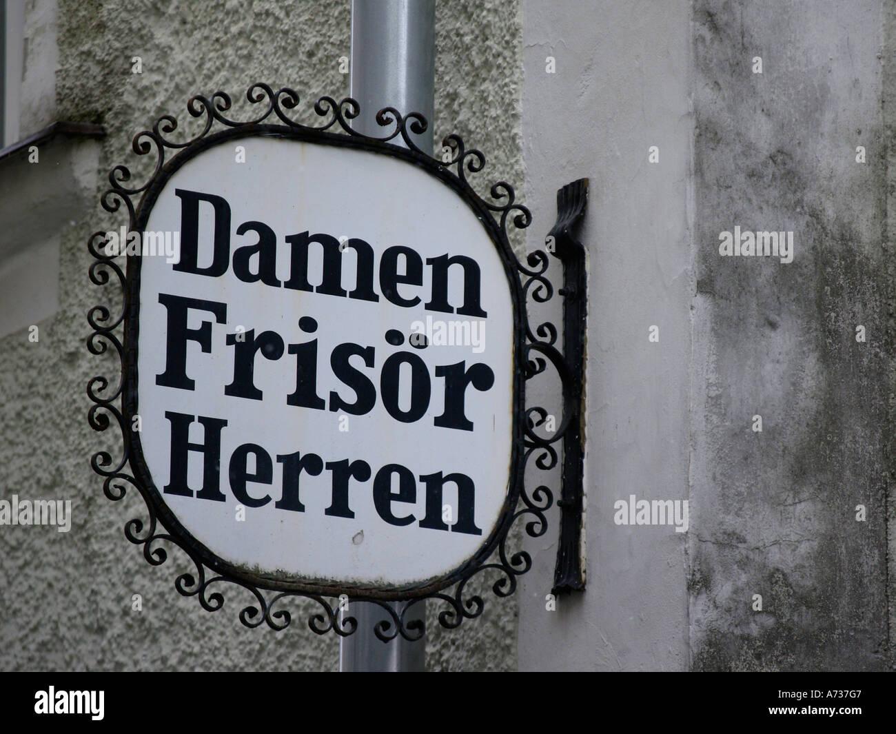 sign Damen Frisör Herren hairdresser for men and women - Stock Image