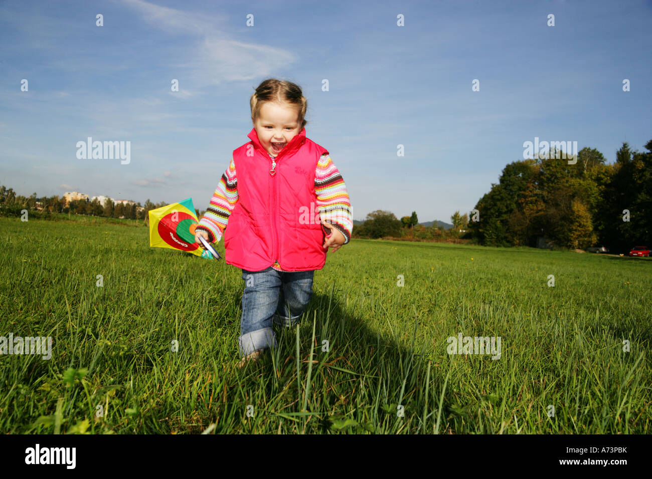 little girl playing with kite - Stock Image