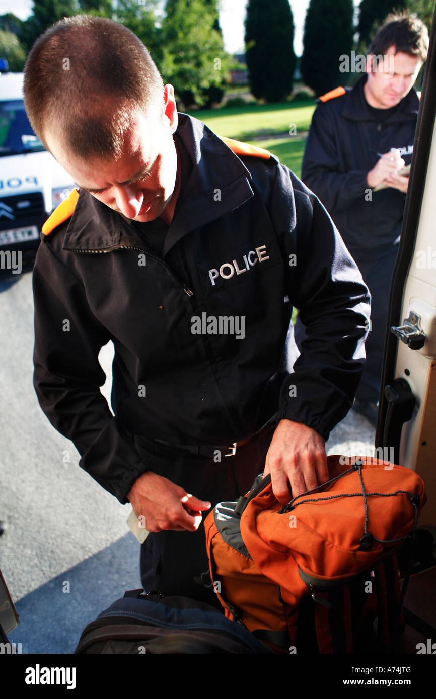 Police search of bag under the implemented section 60 which allows police to search  without warrant near Drax in - Stock Image