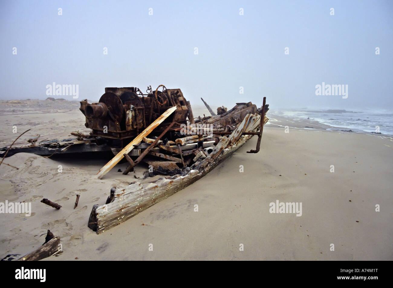 Shipwreck in coastal fog on Skeleton Coast Namiba - Stock Image