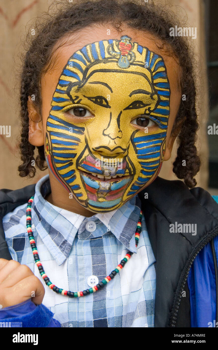 Artistic King Tut face painting on young black African boy - Stock Image