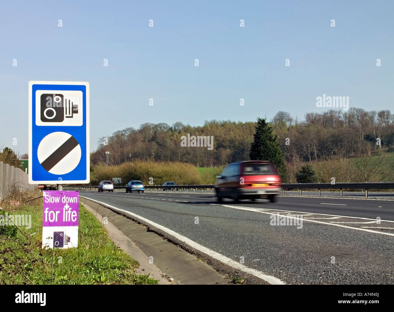 Speed Limit Sign 'Slow Down for Life'  on a British road. - Stock Image