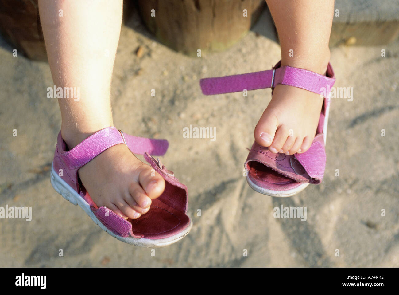 27eead33dc0afe FEET OF 5 YEAR OLD GIRL WITH SANDALS FALLING OFF Stock Photo ...