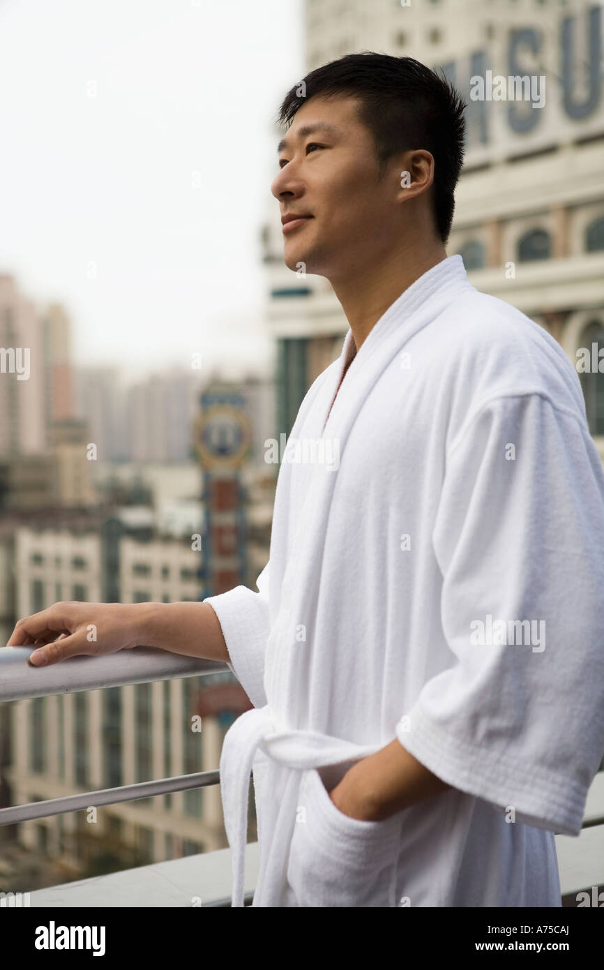 Man In Bathrobe Standing On Balcony Stock Photo Alamy