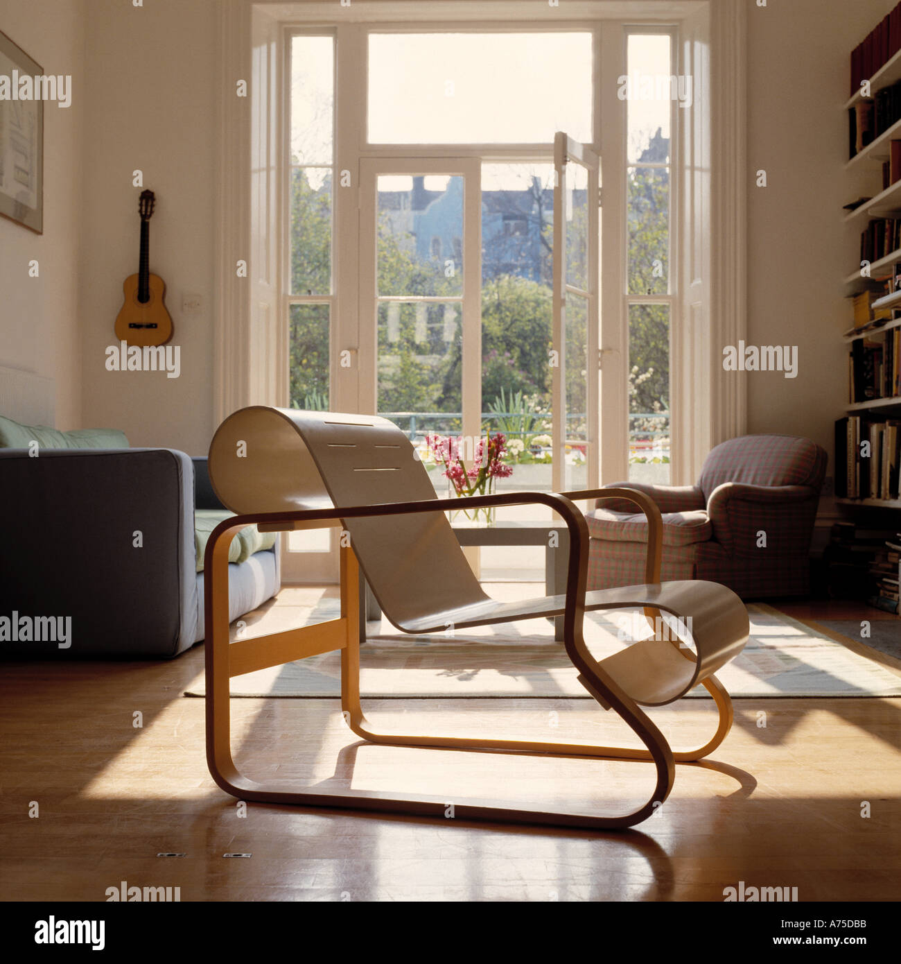Mid Century Modern Chair In Sunlit Modern Living Room With