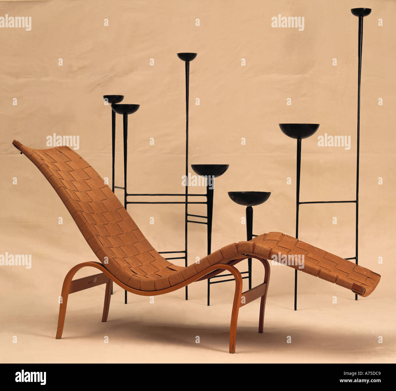 Mid Century Modern Woven Leather Chaise Longue With Tall Wrought Iron Candlesticks