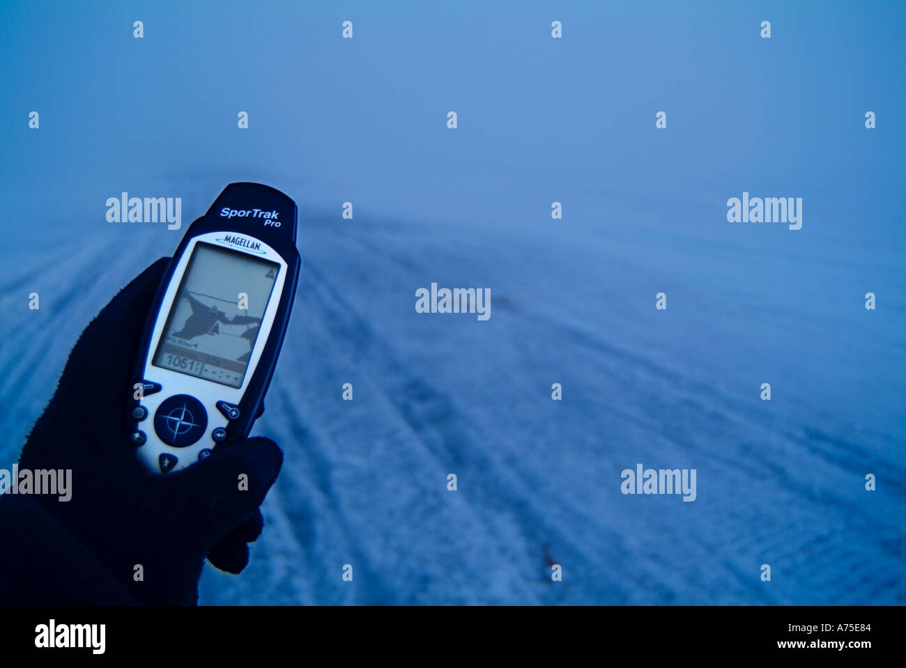 Hand holding a GPS receiver in the fog - Stock Image