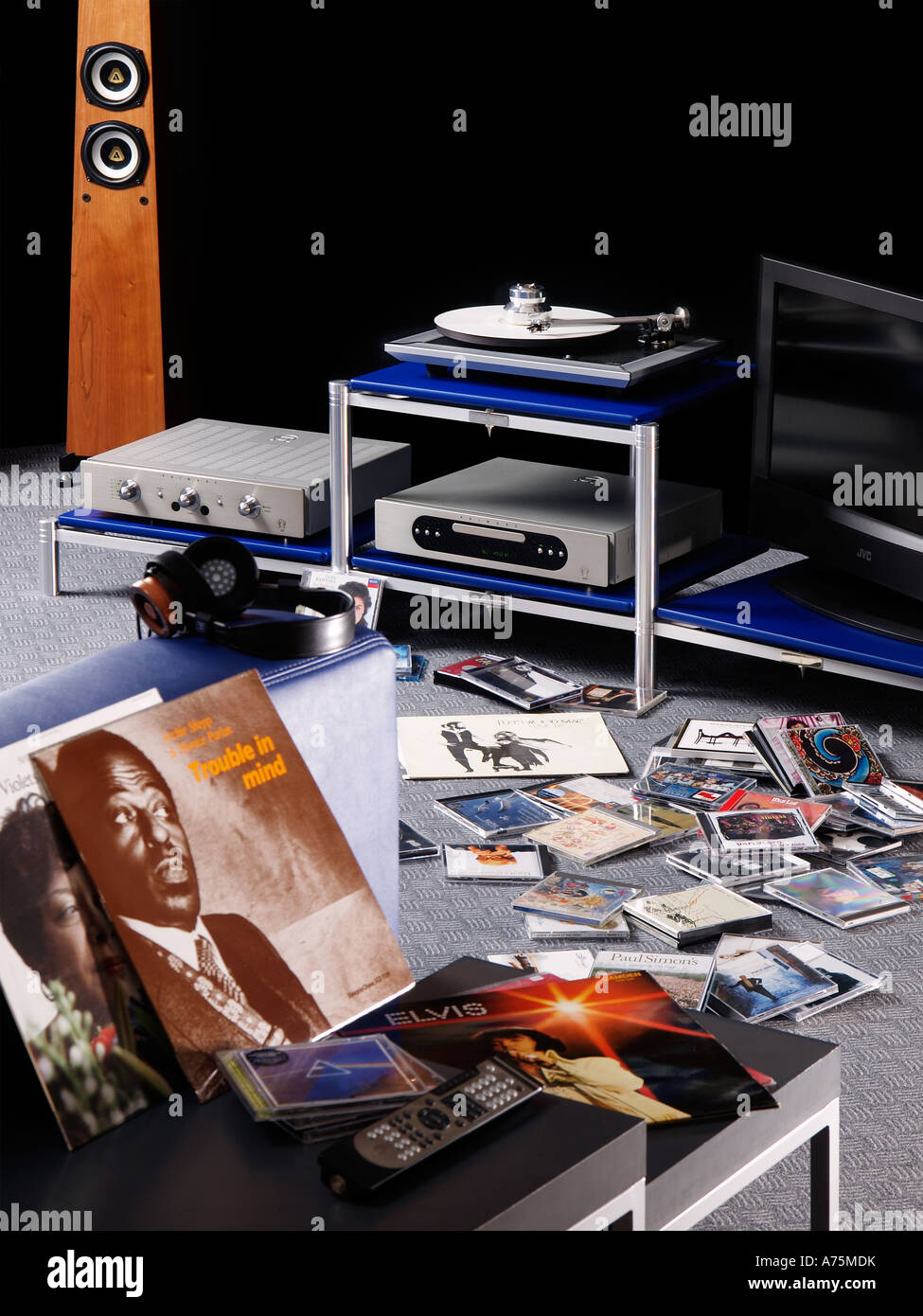 High end audio hifi system with lots of music records cd s headphone remote control hobby relaxing - Stock Image
