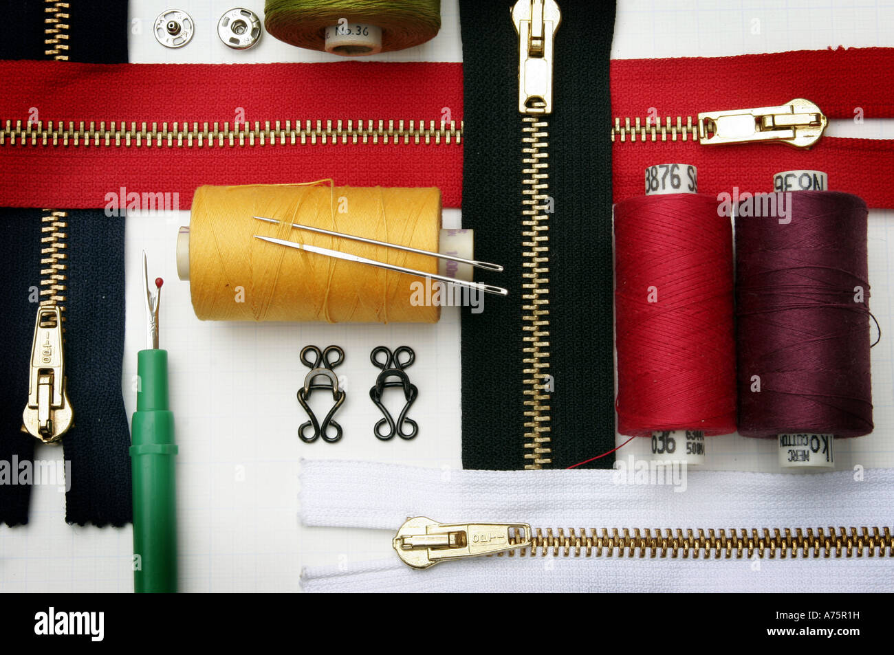 SEWING ITEMS INCLUDING ZIPS,COTTON AND NEEDLES.UK - Stock Image