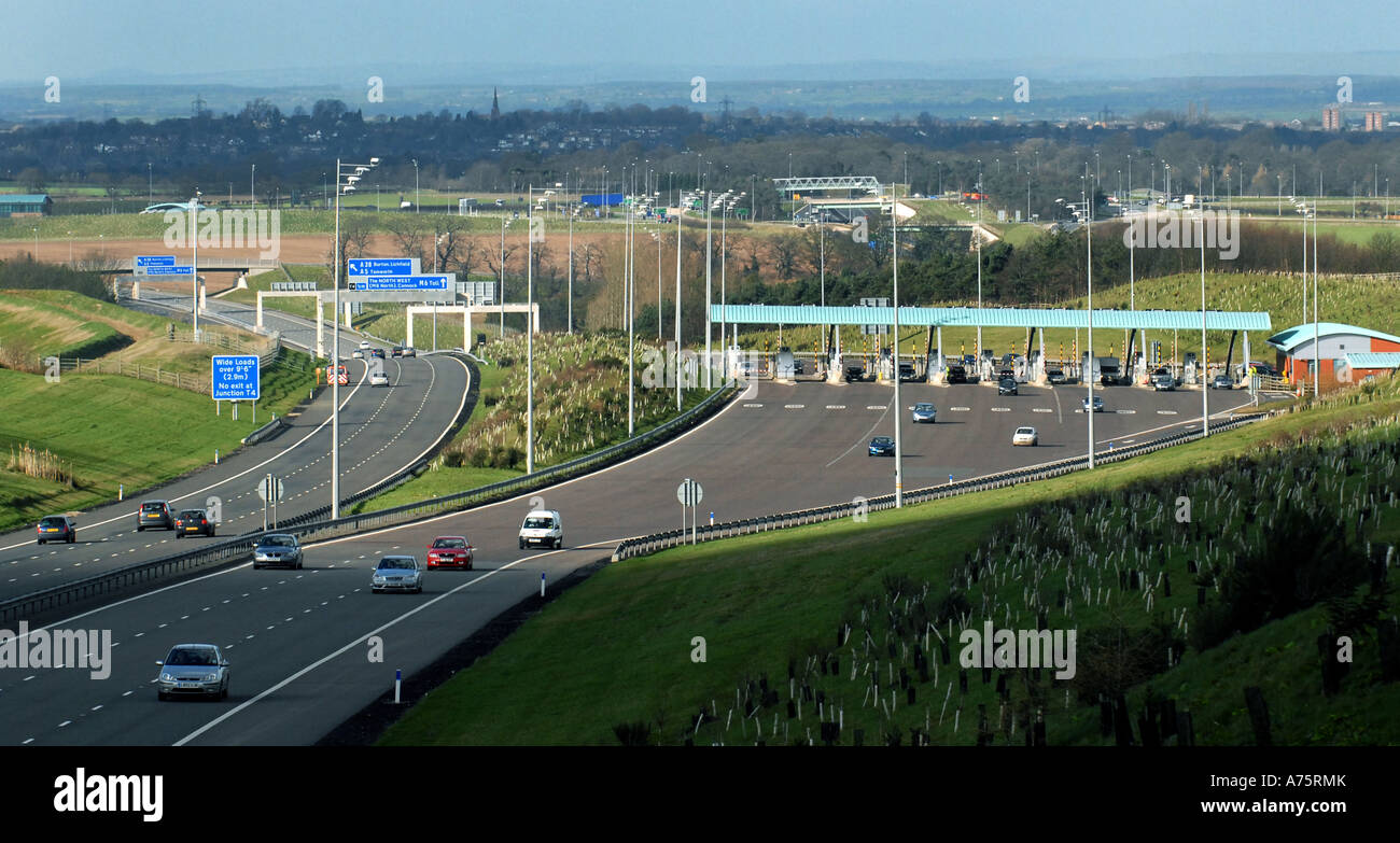 M6 TOLL ROAD BOOTHS AND CARRIAGEWAYS AT WEEFORD NEAR BIRMINGHAM,ENGLAND.UK - Stock Image