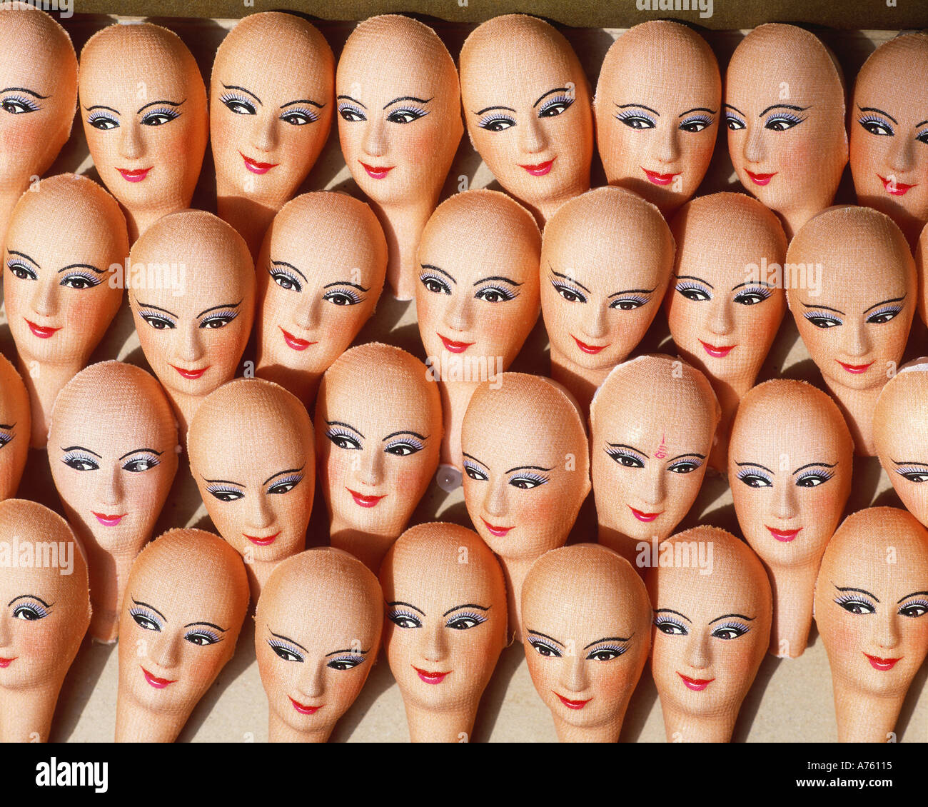 Doll heads in doll factory Bangkok, Thailand - Stock Image