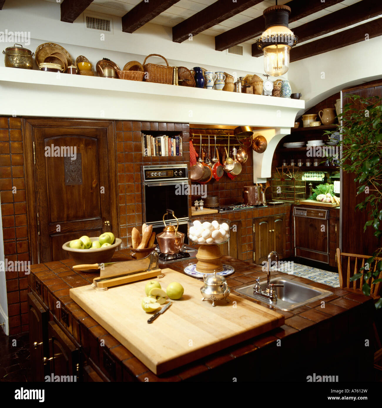 Large Wooden Chopping Board On Island Kitchen Unit With Integral Sink Stock Photo Alamy
