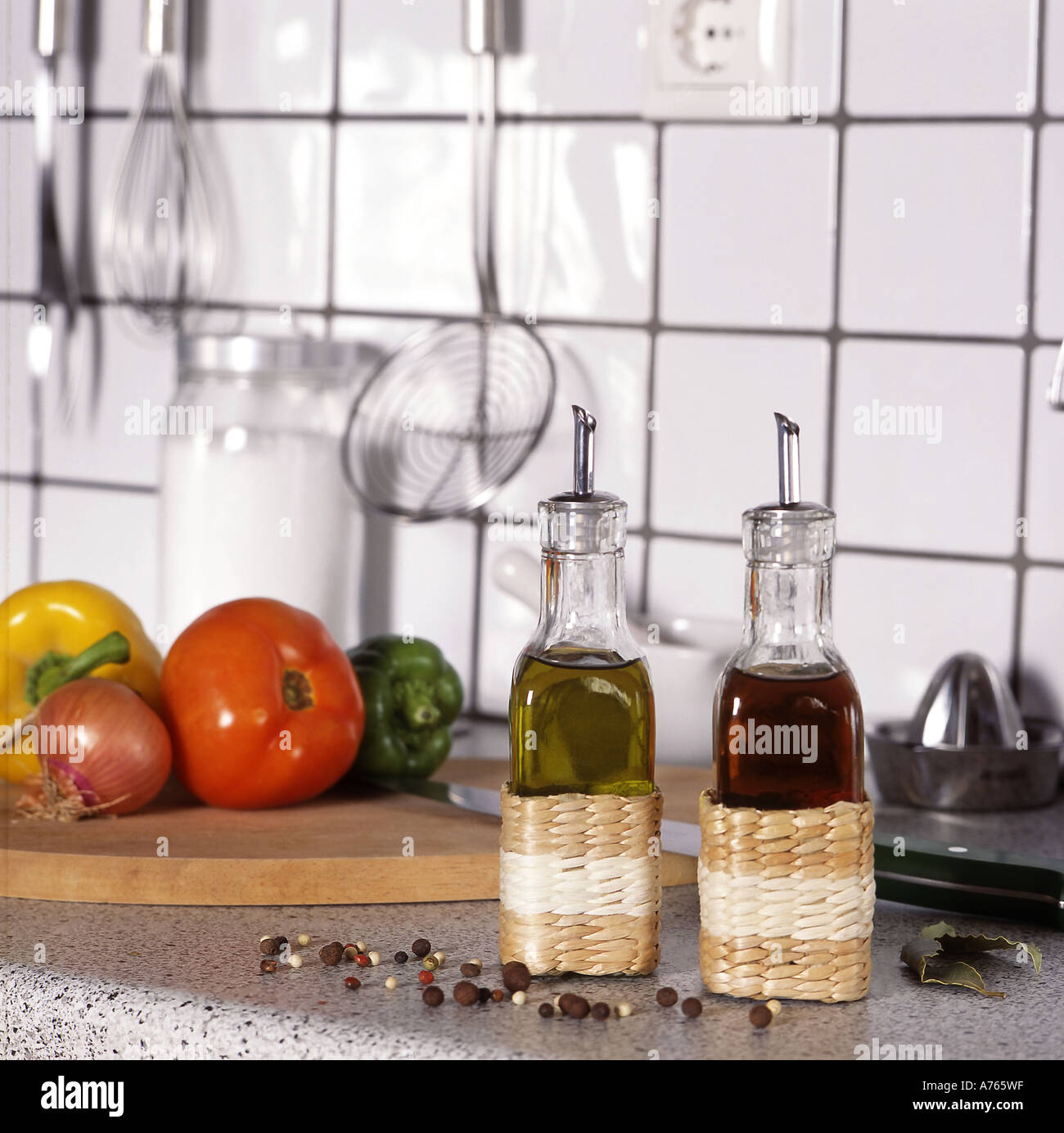 Oil And Vinegar Bottles With Spice And Vegetables On A