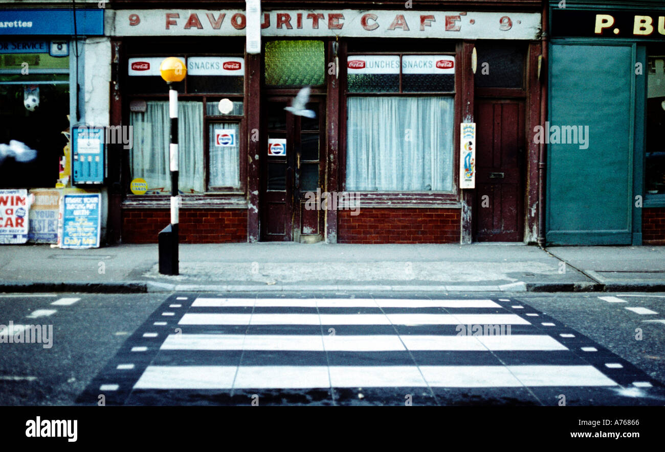 Favourite Cafe Silvertown east London in the 1970s pigeon flying past - Stock Image