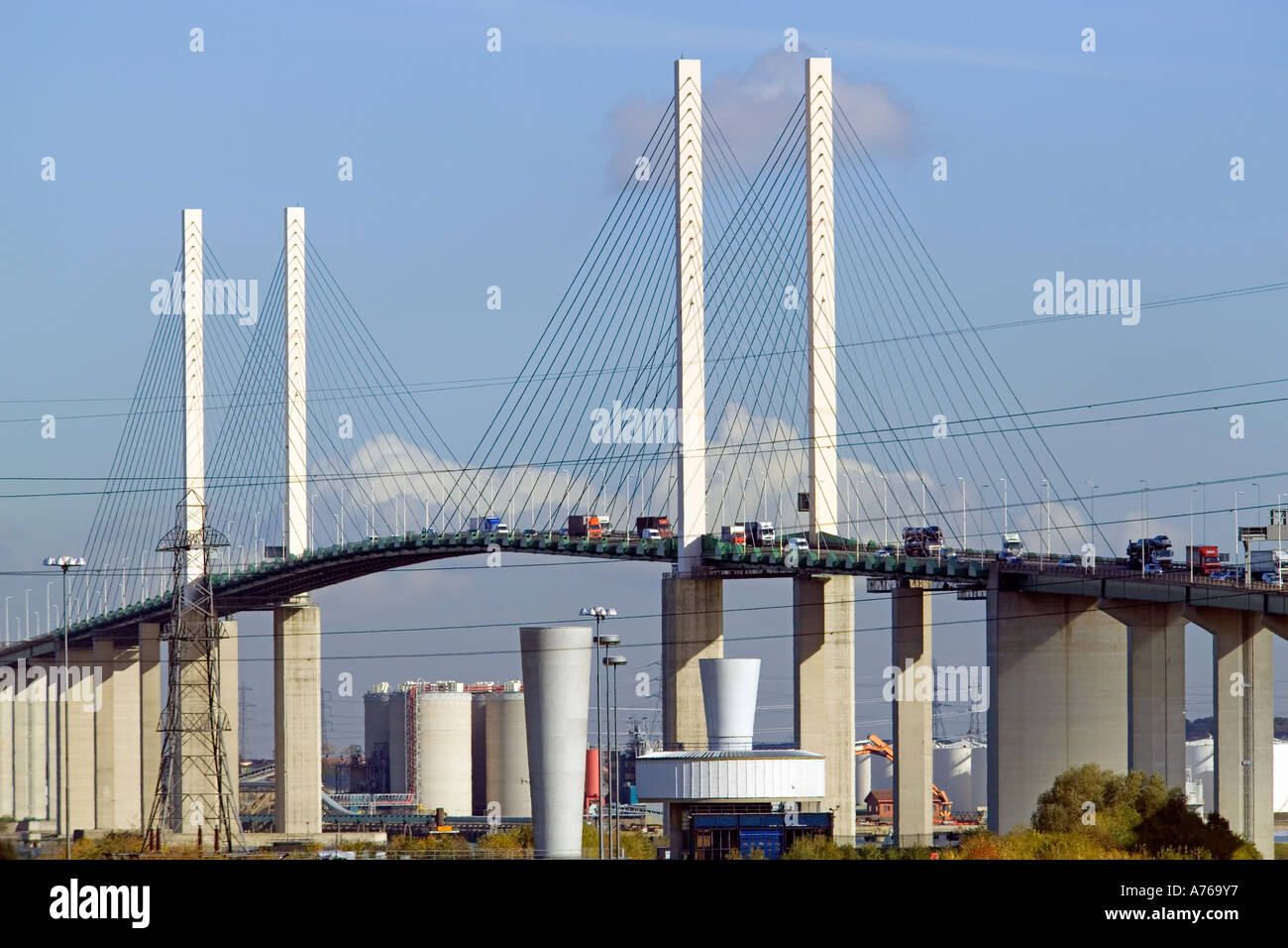 A compressed perspective view of traffic on the QE2 bridge on a sunny day. - Stock Image
