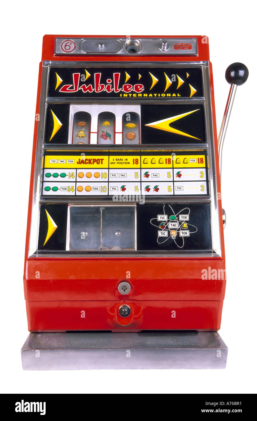 Children's miniature one arm bandit slot machine on a pure white background. Stock Photo
