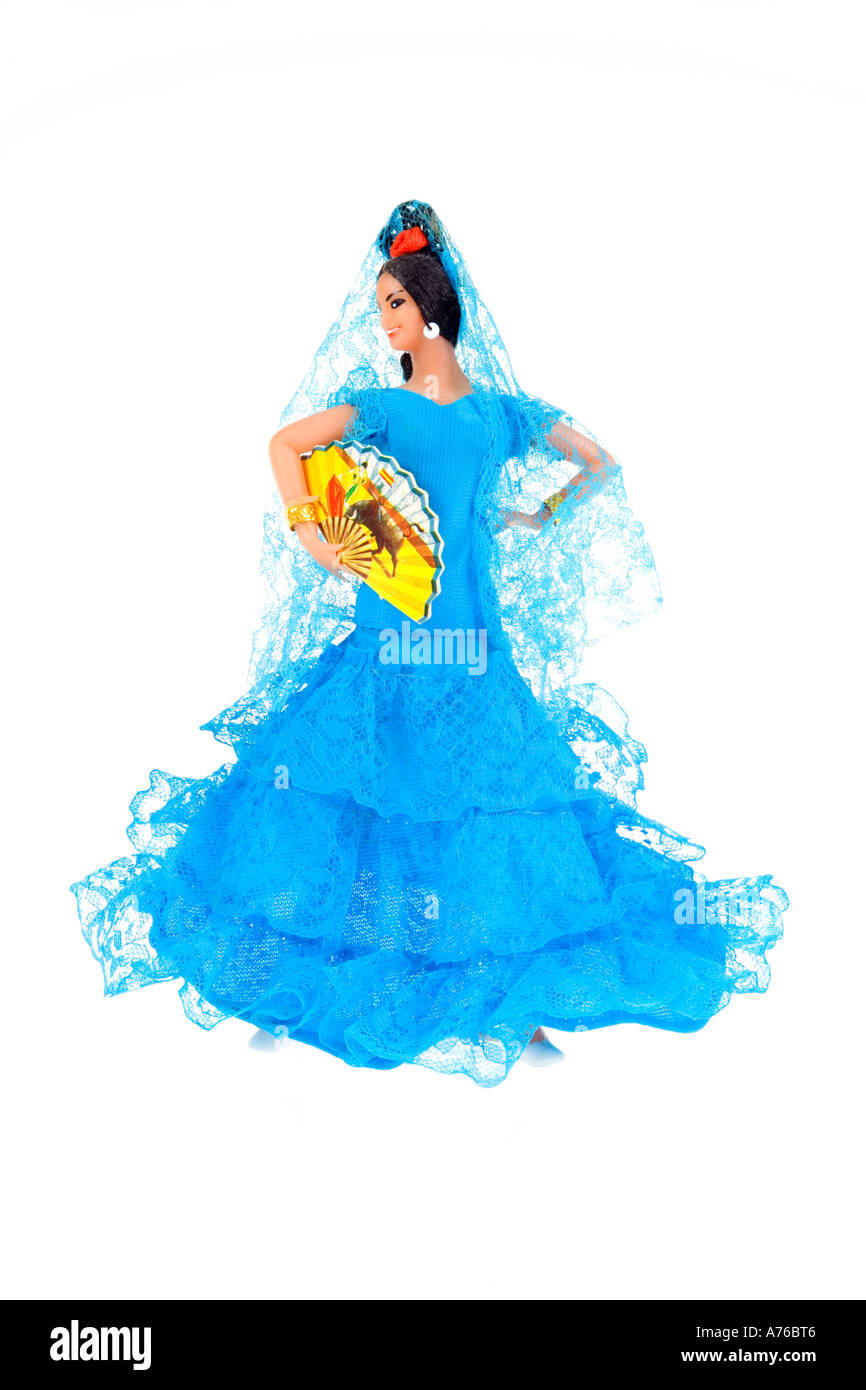 Kitsch female Spanish flamenco dancer doll on a pure white background. - Stock Image