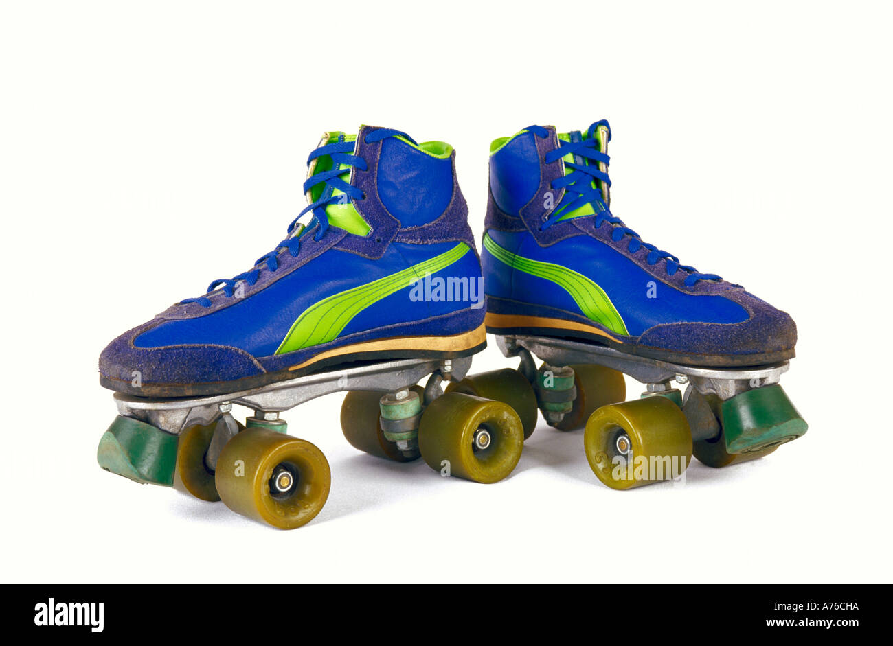 Retro style 1970's 1980's blue roller skates on a white background. - Stock Image