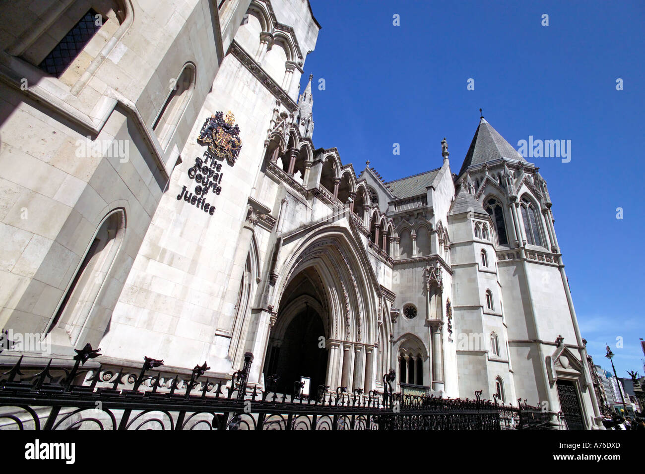 Wide angle view of the main entrance to the Royal Courts of Justice aka Law Courts against a blue sky. Stock Photo