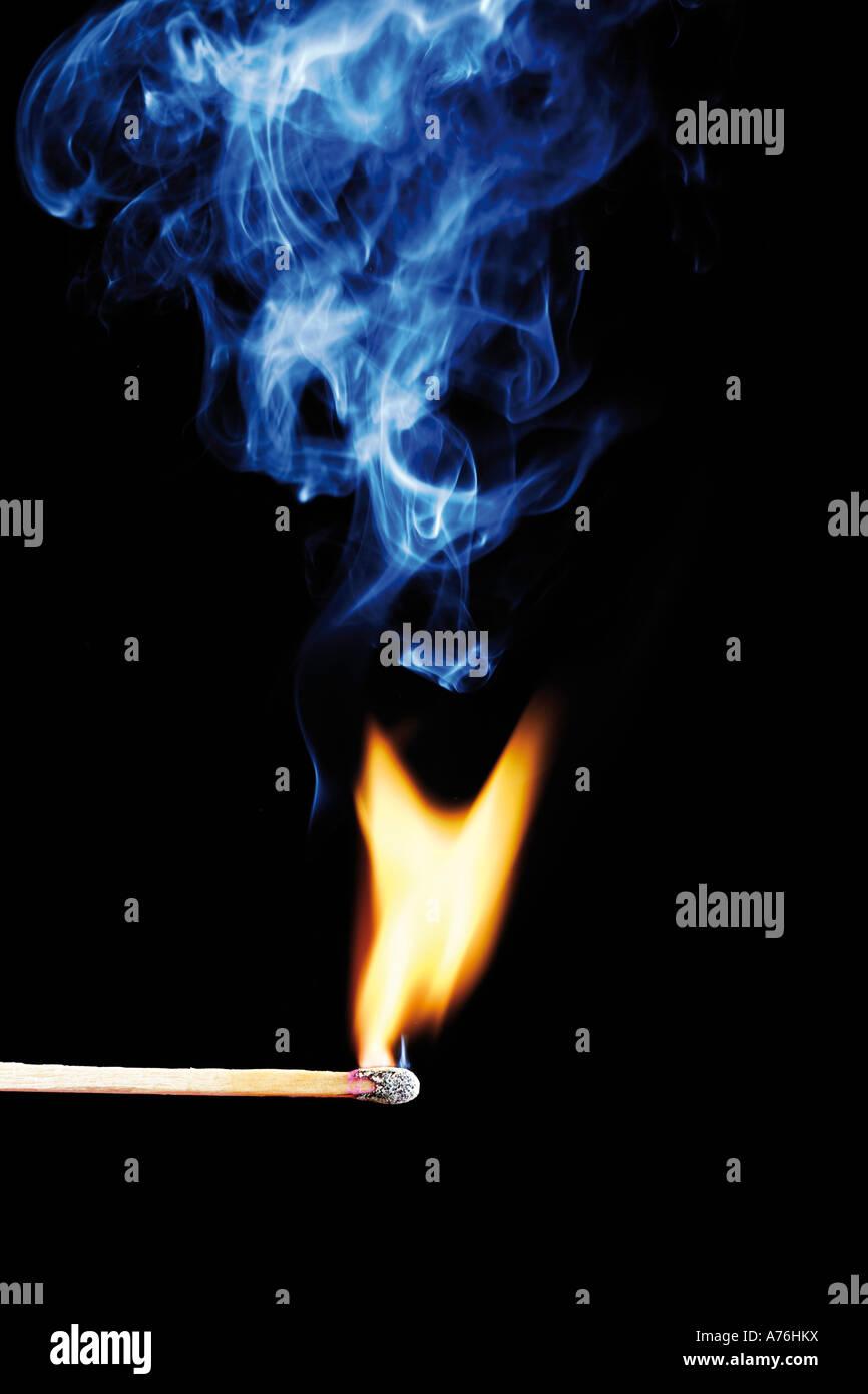 Burning matchstick, close-up - Stock Image