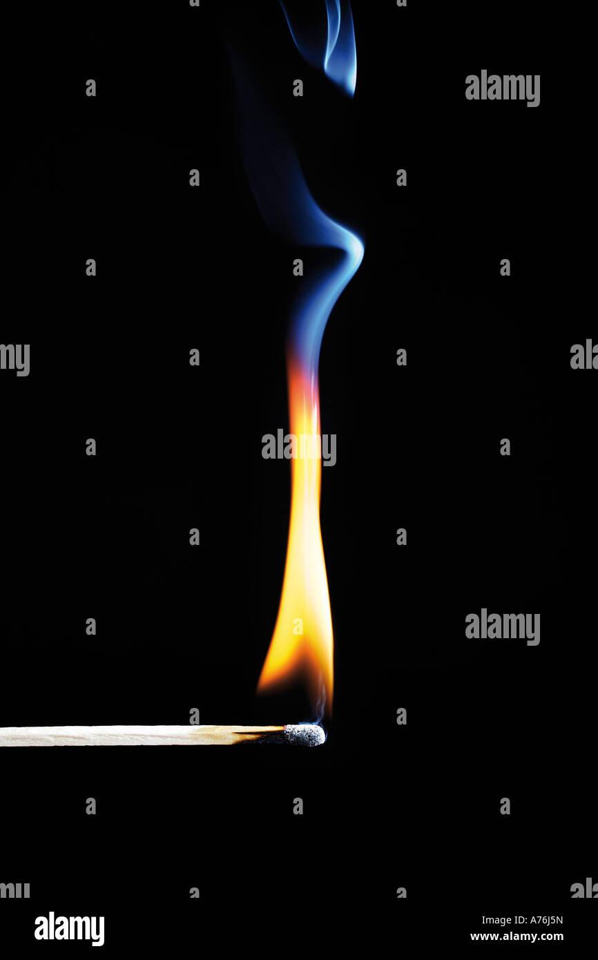 Burning match on black background, close-up - Stock Image